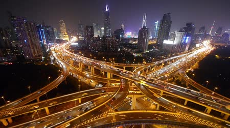 rota : Aerial View of freeway busy city rush hour heavy traffic jam highway,shanghai Yanan East Road Overpass interchange,driving racing by with streaking lights trail with super long exposures. Vídeos