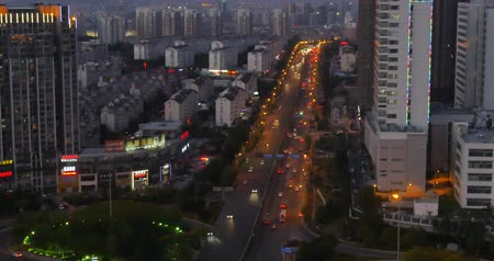 time journey : 4k busy urban traffic jam highway at night,Overpass interchange,urban morden building,QingDao china.