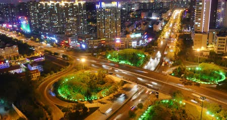 exterior : 4k timelapse busy urban traffic jam highway at night,Overpass interchange,urban morden building,QingDao china.