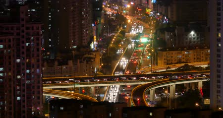 office life : 4k busy urban traffic jam highway at night,Overpass interchange,urban morden building,QingDao china.
