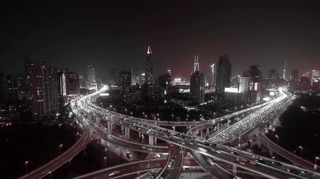 time journey : time lapse,Aerial View of freeway busy city rush hour heavy traffic jam highway,shanghai Yanan East Road Overpass interchange,driving racing by with streaking lights trail with super long exposures.