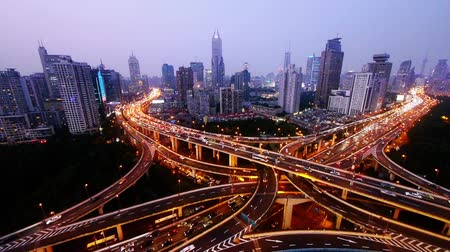 auto estrada : time lapse,Aerial View of freeway busy city rush hour heavy traffic jam highway,shanghai Yanan East Road Overpass interchange,driving & cars racing by with streaking lights trail from day to night.