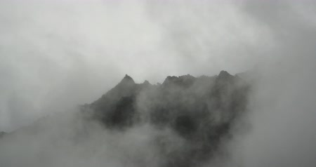 rejtekhely : 4k time lapse of mountain mist rising in the morning,fog pine trees,such as wonderland.Bomi County in tibet,the largest precipitation area in China.