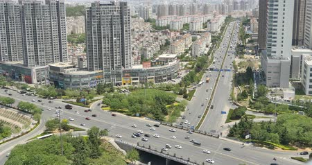 auto estrada : 4k  freeway busy city rush hour heavy traffic jam highway,Overpass interchange,urban morden building,china.