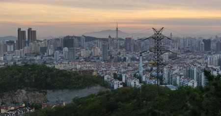 europe population : 4k urban city in dusk,busy traffic jams & business building,QingDao,china. Stock Footage