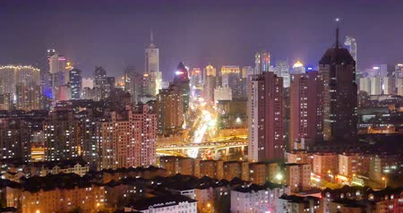 time journey : 4k timelapse busy urban traffic jam highway at night,Overpass interchange,urban morden building,QingDao china.