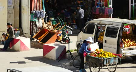 inculto : 4k Fruit stand & grocery store in Shangri-La street,The busy crowd,china.
