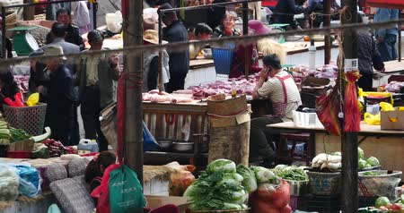 shangri la : 4k large outdoor vegetable trade market in Shangri-La,china,minority women,variety of vegetables and fruits.