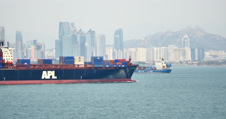 dağıtım : 4k Cargo Container Ships Through The QingDao Harbo,moder urban building,china.