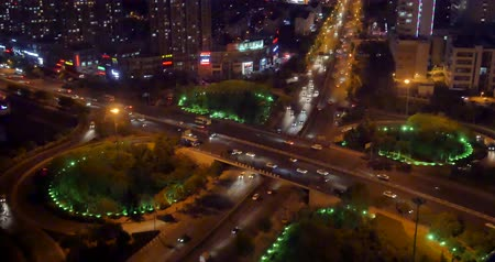 поток : 4k busy urban traffic jam highway at night,Overpass interchange,urban morden building,QingDao china.