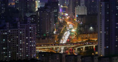 time journey : 4k time lapse busy urban traffic jam highway at night,Overpass interchange,urban modern building,QingDao china. Stock Footage