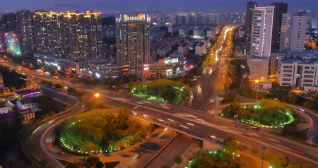 yerleşim : 4k timelapse busy urban traffic jam highway at night,Overpass interchange,urban morden building,QingDao china.