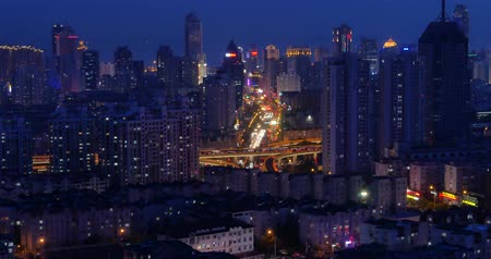 encruzilhada : 4k busy urban traffic jam highway at night, Overpass interchange, urban morden building, QingDao china.