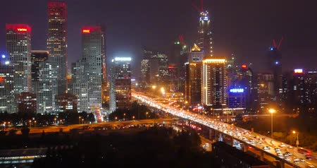 road construction : 4k,Aerial View of heavy traffic through BeiJing central business district that is located in the Chaoyang district at night,Its the main hub for financial and business activities in Chinas capital city. Stock Footage