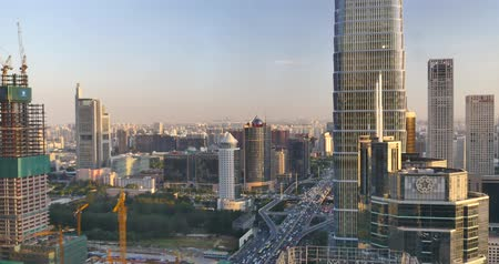 felhőkarcoló : 4k,Aerial View of heavy traffic through BeiJing central business district that is located in the Chaoyang district,Its the main hub for financial and business activities in Chinas capital city.