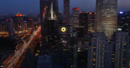 atividades : 4k,Aerial View of heavy traffic through BeiJing central business district that is located in the Chaoyang district at night,Its the main hub for financial and business activities in Chinas capital city. Stock Footage