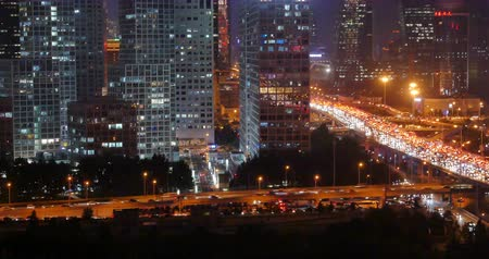 office life : 4k,timelapse,Aerial View of heavy traffic through BeiJing central business district that is located in the Chaoyang district at night,Its the main hub for financial and business activities in Chinas capital city. Stock Footage