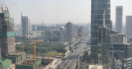 bruk : 4k,Aerial View of heavy traffic through BeiJing central business district that is located in the Chaoyang district,Its the main hub for financial and business activities in Chinas capital city.