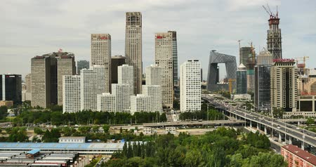 notas : 4k,Aerial View of heavy traffic through BeiJing central business district that is located in the Chaoyang district,Its the main hub for financial and business activities in Chinas capital city.