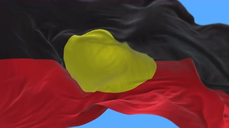 управлять : 4k seamless Close up of AUSTRLIA ABORIGINES Aboriginal flag slow waving with visible wrinkles.A fully digital rendering,The animation loops at 20 seconds.flag 3D animation with alpha channel included.