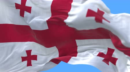 ensign : 4k seamless Close up of Georgia flag slow waving with visible wrinkles.A fully digital rendering,The animation loops at 20 seconds.flag 3D animation with alpha channel included.