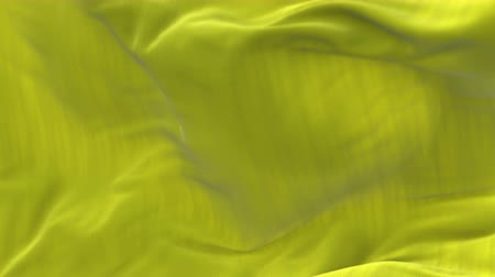 atlaszfényû : 4k seamless Wave yellow satin fabric Background.Silk cloth fluttering in the wind.tenderness and airiness.3D digital animation of a waving cloth. Stock mozgókép