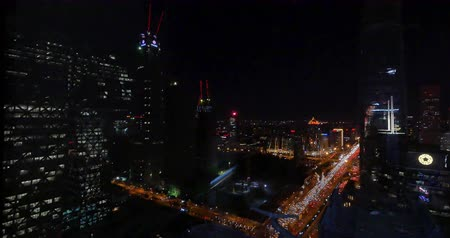 notas : 4k,timelapse,Aerial View of heavy traffic through BeiJing central business district that is located in the Chaoyang district at night,Its the main hub for financial and business activities in Chinas capital city. Stock Footage