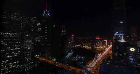 notas : 4k,Aerial View of heavy traffic through BeiJing central business district that is located in the Chaoyang district at night,Its the main hub for financial and business activities in Chinas capital city. Stock Footage