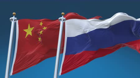 marş : 4k Seamless Russia and China Flags with blue sky background,A fully digital rendering,The animation loops at 20 seconds,RUS CN. Stok Video