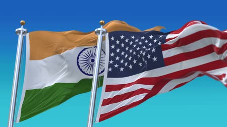 marş : 4k Seamless United States of America And India Flags with blue sky background,A fully digital rendering,The flag 3D animation loops at 20 seconds,USA IND IN. Stok Video