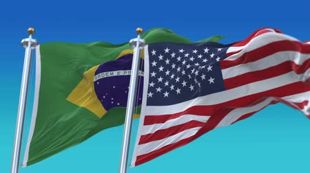 marş : 4k Seamless United States of America And Brazil Flags with blue sky background,A fully digBRAl rendering,The flag 3D animation loops at 20 seconds,USA BRA. Stok Video