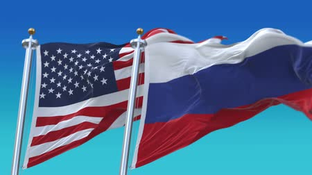 yumuşaklık : 4k Seamless United States of America And Russia Flags with blue sky background,A fully digital rendering,The flag 3D animation loops at 20 seconds,USA RUS. Stok Video