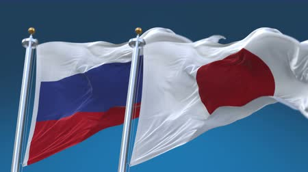 yumuşaklık : 4k Seamless Russia and Japan Flags with blue sky background,A fully digital rendering,The animation loops at 20 seconds,RUS JP.