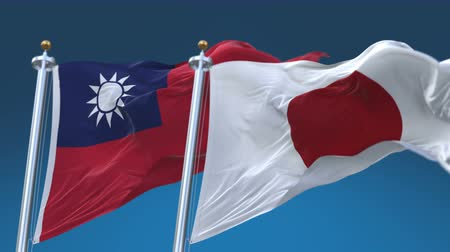 oy : 4k Seamless Taiwan and Japan Flags with blue sky background,A fully digital rendering,The animation loops at 20 seconds,TWN JP. Stok Video