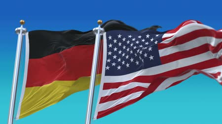gép : 4k Seamless United States of America And Germany Flags with blue sky background,A fully digital rendering,The flag 3D animation loops at 20 seconds,USA GER DE.
