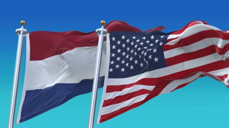 elections : 4k Seamless United States of America And Netherlands Holland Flags with blue sky background,A fully digNLl rendering,The flag 3D animation loops at 20 seconds,USA NL.