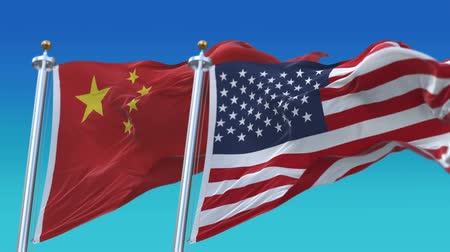 yumuşaklık : 4k United States of America and China Flags with blue sky background.