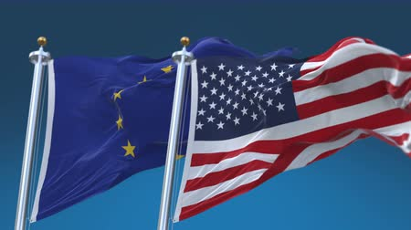 marş : 4k Usa United States of America And European Union EU Flags with blue sky background. Stok Video