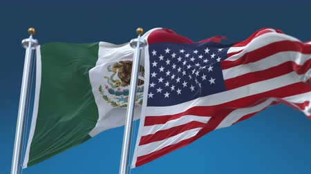 marş : 4k United States of America And Mexico Flags with blue sky background.