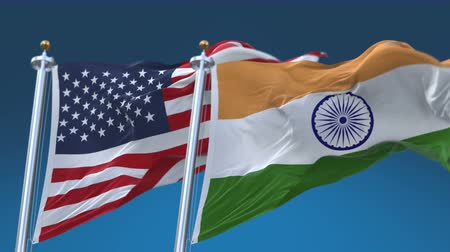 yumuşaklık : 4k United States of America And India Flags with blue sky background.