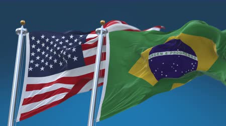 yumuşaklık : 4k Seamless United States of America And Brazil Flags with blue sky background,A fully digBRAl rendering,The flag 3D animation loops at 20 seconds,USA BRA. Stok Video