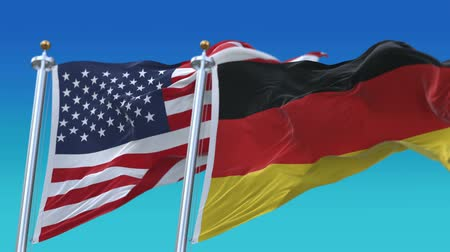 yumuşaklık : 4k Seamless United States of America And Germany Flags with blue sky background,A fully digital rendering,The flag 3D animation loops at 20 seconds,USA GER DE.