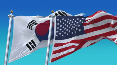 marş : 4k Seamless United States of America And South Korea Flags with blue sky background,A fully digital rendering,The flag 3D animation loops at 20 seconds,USA KOR.