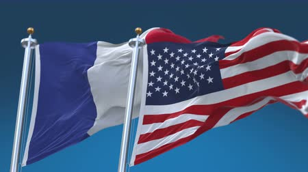 demokratický : 4k Seamless United States of America And France Flags with blue sky background,A fully digital rendering,The flag 3D animation loops at 20 seconds,USA FRA.