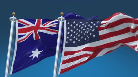 marş : 4k Seamless United States of America And Australia Flags with blue sky background,A fully digital rendering,The flag 3D animation loops at 20 seconds,USA AUS AU. Stok Video