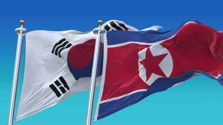 marş : 4k Seamless North Korea and Republic of Korea Flags with blue sky background,A fully digital rendering,The animation loops at 20 seconds,PRK KP KOR KR.