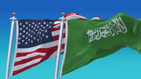 marş : 4k Seamless United States of America And Saudi Arabia Flags with blue sky background,A fully digKSAl rendering,The flag 3D animation loops at 20 seconds,USA KSA. Stok Video