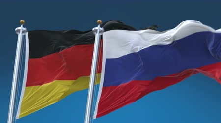 marş : 4k Seamless Germany and Russia Flags with blue sky background,A fully digital rendering,The animation loops at 20 seconds,GER DE RUS RU. Stok Video