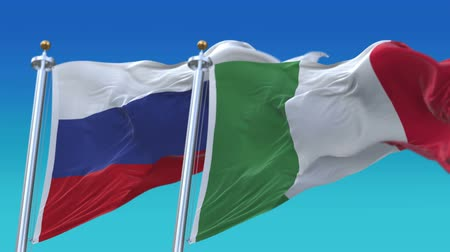 флагшток : 4k Seamless Italy and Russia Flags with blue sky background,A fully digital rendering,The animation loops at 20 seconds,ITA IT RUS RU. Стоковые видеозаписи