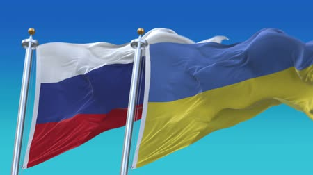 marş : 4k Seamless Ukraine and Russia Flags with blue sky background,A fully digital rendering,The animation loops at 20 seconds,UKR UA RUS RU. Stok Video